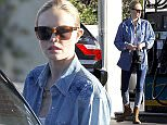 Los Feliz, CA - Kate Bosworth stops by a gas station this afternoon to fuel up her BMW X3 and looked fashionable doing so.  The actress wore a white top with a denim button up shirt, which she paired with ombre skinny jeans, brown star-studded boots and toted a mini black bag. AKM-GSI         December 13,  2014 To License These Photos, Please Contact :   Steve Ginsburg (310) 505-8447 (323) 423-9397 steve@akmgsi.com sales@akmgsi.com   or   Maria Buda (917) 242-1505 mbuda@akmgsi.com ginsburgspalyinc@gmail.com