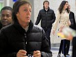 EXCLUSIVE TO INF. December 14, 2014: Paul McCartney and his wife Nancy Shevell are pictured arriving at JFK International Airport. Mandatory Credit: Elder Ordonez/INFphoto.com Ref: infusny-274