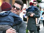 West Hollywood, CA - Singer Robin Thicke looks quite happy and content and he cradles his sleeping son, Julian, while out holiday shopping in West Hollywood.  \n  \nAKM-GSI       December 13, 2014\nTo License These Photos, Please Contact :\nSteve Ginsburg\n(310) 505-8447\n(323) 423-9397\nsteve@akmgsi.com\nsales@akmgsi.com\nor\nMaria Buda\n(917) 242-1505\nmbuda@akmgsi.com\nginsburgspalyinc@gmail.com