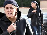 UK CLIENTS MUST CREDIT: AKM-GSI ONLY\nEXCLUSIVE: A make-up free, Sharon Stone, spotted leaving, XIV Karats.  The legendary actress was seen with a hooded jacket that she used to cover herself as she payed for valet with a $100 bill.\n\nPictured: Sharon Stone\nRef: SPL911257  121214   EXCLUSIVE\nPicture by: AKM-GSI / Splash News\n\n