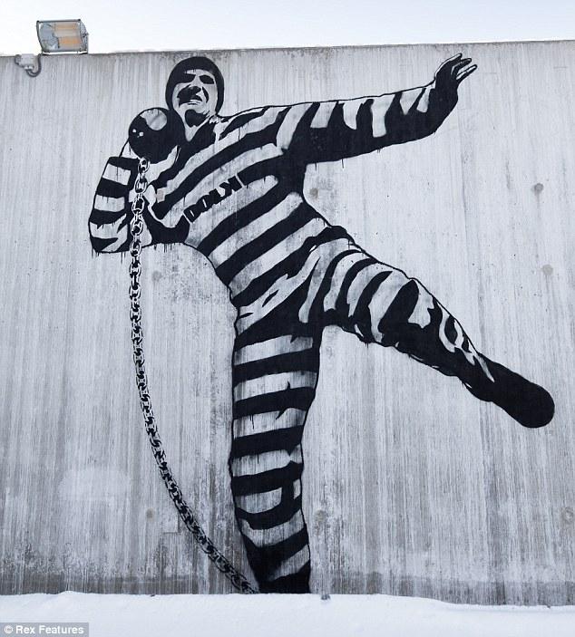 Banksy-style: A £1million mural in the prison courtyard by Norwegian street artist Dolk