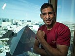 Amir Khan speaks to the British Press in his Hotel room after his win against Devon Alexander at The MGM Grand Garden Arena in Las Vegas last night 15th December 2014 Picture By Mark Robinson.