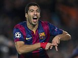 epa04523868 FC Barcelona's Uruguayan striker Luis Suarez celebrates after scoring his team's third goal during the Champions League group F soccer match between Barcelona and Paris Saint Germain at Nou Camp stadium in Barcelona, Spain, 10 December 2014.  EPA/ALEJANDRO GARCIA