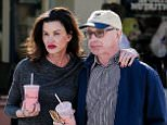 EXCLUSIVE TO INF. December 13, 2014: Janice Dickson shows nothing but love for her fiance Dr. Robert Gerner as as they share a kiss while grabbing healthy milkshakes at Vitamin Barn in Malibu, CA. Mandatory Credit: Borisio/INFphoto.com Ref: infusla-277