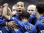 Fredrik Ljungberg, left, is congratulated by team mates Thierry Henry, centre back, Ashley Cole, centre foreground, and Robin Van Percy, right, after scoring the first goal against Southampton during their Premiereship match at Southampton's St. Mary's ground Saturday Feb. 26, 2005 (AP Photo/Adam Butler)  ** NO INTERNET/MOBILE USAGE WITHOUT FAPL LICENCE - SEE IPTC SPECIAL INSTRUCTIONS FIELD FOR DETAILS **