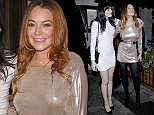 Celebrities at the Love x Balmain Christmas Party at The Ivy Market Grill on 15 December 2014.  Pictured: Ali Lohan and Lindsay Lohan Ref: SPL913251  151214   Picture by: Splash News  Splash News and Pictures Los Angeles: 310-821-2666 New York: 212-619-2666 London: 870-934-2666 photodesk@splashnews.com