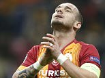 epa04522203 Galatasaray's Wesley Sneijder reacts after missing a chance to score during the UEFA Champions League  group D match between Galatasaray  and Arsenal in Istanbul, Turkey, 09 December 2014.  EPA/TOLGA BOZOGLU
