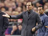 Mandatory Credit: Photo by Hollandse Hoogte/REX (4294280j)  Giorgos Donis of Apoel FC, coach Frank de Boer of Ajax  Ajax v Apoel Nicosia, Champions League football match, Amsterdam Arena, Amsterdam, Netherlands - 10 Dec 2014