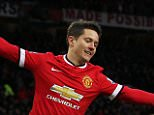 Ander Herrera of Manchester United celebrates the goal scored by Robin van Persie 3-0