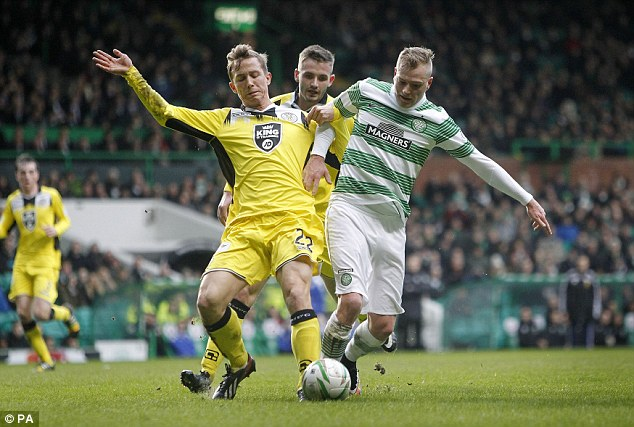Celtic striker John Guidetti (right) scored  but also had to limp off injured in the second half