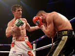 """File photo dated 19/04/14 of boxer Anthony Crolla (left) in action against John Murray as Crolla is in hospital after confronting burglars. PRESS ASSOCIATION Photo. Issue date: Tuesday December 16, 2014. Sports promoter Eddie Hearn tweeted: """"Gutted to confirm that @ant_crolla is in hospital with a head and ankle injury after confronting burglars at/near his property."""" See PA story POLICE Boxer. Photo credit should read: Martin Rickett/PA Wire"""