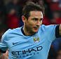 Frank Lampard of Manchester City celebrates scoring his goal to make the score 0-1