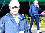 UK CLIENTS MUST CREDIT: AKM-GSI ONLY EXCLUSIVE: Bruce Jenner stops by Starbucks to get an afternoon pick me up after playing a round of golf in Brentwood, CA.  The reality star was out alone and was dressed in a light blue polo shirt with a Nike windbreaker and blue trousers.  There have been ongoing rumors that Bruce is slowly transforming himself into looking more feminine, especially after painting his nails recently.  Although Bruce looked like his usual self today, it looks like he prefers to grow out his nails.  Pictured: Bruce Jenner Ref: SPL913860  161214   EXCLUSIVE Picture by: AKM-GSI / Splash News