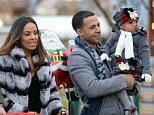 EXCLUSIVE: Former JLS singer Marvin Humes at Winter Wonderland with his wife Rochelle and their daughter. The family were seen enjoying the rides at the Hyde Park Christmas theme park.  Pictured: Marvin Humes and Alaia-Mai Humes Ref: SPL912150  161214   EXCLUSIVE Picture by: W8 Media / Splash News  Splash News and Pictures Los Angeles:310-821-2666 New York:212-619-2666 London:870-934-2666 photodesk@splashnews.com