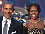 WASHINGTON, DC - DECEMBER 14: U.S. President Barack Obama and First Lady Michelle Obama speak onstage at TNT Christmas in Washington 2014 at the National Building Museum on December 14, 2014 in Washington, DC.  25248_001_0621.JPG  (Photo by Theo Wargo/WireImage)