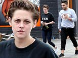 """Picture Shows: Kristen Stewart  December 16, 2014\n \n """"Twilight"""" star Kristen Stewart makes a morning coffee run with a male friend in Los Feliz, California. Kristen dressed casually in a black sweater and navy blue skinny jeans.\n \n Exclusive - All Round\n UK RIGHTS ONLY\n \n Pictures by : FameFlynet UK © 2014\n Tel : +44 (0)20 3551 5049\n Email : info@fameflynet.uk.com"""