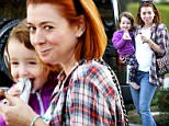 UK CLIENTS MUST CREDIT: AKM-GSI ONLY\nEXCLUSIVE: Alyson Hannigan and her daughter Satyana looked picture perfect as they stepped out together on a rainy day in L.A. The doting mom, who was dressed in a plaid shirt and jeans,  kindly shared a nutrition bar with her little girl.\n\nPictured: Alyson Hannigan and Satyana Denisof\nRef: SPL914041  161214   EXCLUSIVE\nPicture by: AKM-GSI / Splash News\n\n