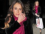 16.DECEMBER.2014 - LONDON - UK **EXCLUSIVE ALLROUND PICTURES** ENGLISH ACTRESS AND MODEL ELIZABETH HURLEY SEEN LEAVING HER HOUSE FOR THE EVENING CARRYING A SHOPPING BAG FROM HER OWN SWIMWEAR AND CLOTHING COLLECTION BYLINE MUST READ : XPOSUREPHOTOS.COM ***UK CLIENTS - PICTURES CONTAINING CHILDREN PLEASE PIXELATE FACE PRIOR TO PUBLICATION *** **UK CLIENTS MUST CALL PRIOR TO TV OR ONLINE USAGE PLEASE TELEPHONE 0208 344 2007**