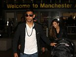 Boxer Amir Khan flies back into Manchester from the States after his win over Devon Alexander in Las Vegas. He was accompanied by his wife Faryal Makhdoom and their baby daughter Lamysa. 16 December 2014. Please byline: Peter Goddard/Vantagenews.co.uk