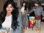LOS ANGELES, CA - DECEMBER 15:  Kylie Jenner and recording artist Tyga arrive bearing gifts at the LA Gear Presents Teen Impact Holiday Party Hosted By Tyga At Childrens Hospital LA on December 15, 2014 in Los Angeles, California.  (Photo by Lilly Lawrence/WireImage)