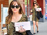 EXCLUSIVE: Dakota Johnson wears a leopard print dress and a black coat in West Hollywood. Dakota was all smiles as she headed out to get her nails done, and then stopped by to pick up some fresh baked vegan pastries at Baby Cakes  Pictured: Dakota Johnson Ref: SPL913156  151214   EXCLUSIVE Picture by: Splash News  Splash News and Pictures Los Angeles: 310-821-2666 New York: 212-619-2666 London: 870-934-2666 photodesk@splashnews.com