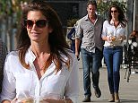 EXCLUSIVE TO INF. December 15, 2014: Cindy Crawford and Rande Gerber grab a sandwich to-go from Vintage Farmers Market. Mandatory Credit: Sasha Lazic/INFphoto Ref: infusla-257