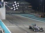 Mercedes driver Lewis Hamilton of Great Britain takes the checkered flag to win Abu Dhab Formula one at the Yas Marina racetrack in Abu Dhabi, United Arab Emirates.   FILE. In this Sunday, Nov. 23, 2014 file photo. (AP Photo/Kamran Jebreili, File)