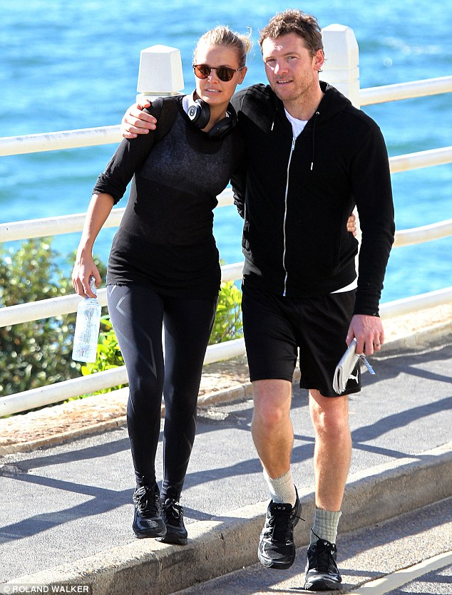 Snuggle buddies: The model and actor cosy up on a walk back from Bondi on Tuesday