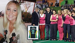 POOL SHOOT..North Coast Raiders players lay flowers at the memorial to Lizzie Watkins who died in a freak hockey accident last week.... The Watkins family, lead by father Frank Watkins as they retired Lizzies number......PHOTOGRAPH BY SHARON SMITH..WANEWSPAPERS FAIRFAX FIN REVIEW ONLINE OUT