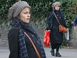 MUST BYLINE: EROTEME.CO.UK\nHelena Bonham Carter does some last minute Christmas shopping on Hampstead high street.\nEXCLUSIVE    December 19,  2014\nJob: 141220L1  London, England \nEROTEME.CO.UK\n44 207 431 1598\n