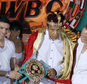"""FILE - In this Monday, Dec. 3, 2012, file photo, the former heavyweight boxing champion Muhammad Ali, center, is crowned """"King of Boxing"""" while accompanied by his wife, Lonnie, right, and Argentine boxer Sergio Martinez during the 50th convention of the World Boxing Council in Cancun, Mexico. Spokesman Bob Gunnell said Saturday, Dec. 20, 2014, that the 72-year-old boxing great has been hospitalized with a mild case of pneumonia and is in stable condition. (AP Photo/Israel Leal, File)"""