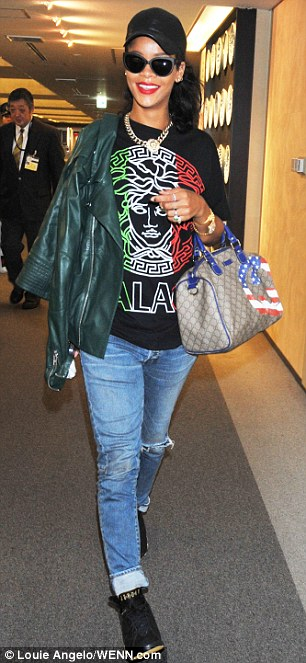 Smiling again: Rihanna was bright and breezy at Narita Airport in Japan today