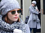 130631, EXCLUSIVE: Emma Stone seen leaving a restaurant in West Village, NYC. New York, New York - Sunday December 21, 2014. Photograph: © PacificCoastNews. Los Angeles Office: +1 310.822.0419 sales@pacificcoastnews.com FEE MUST BE AGREED PRIOR TO USAGE