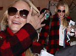 LeAnn Rimes travels casual for her flight to LA, wearing black pants and red plaid.  The star recently tweeted a photo of her perfectly toned abs, not putting on an ounce of weight as the holidays wear on, Sunday, December 21, 2014  X17online.com