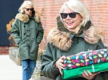Michelle Williams was spotted placing what appeared to be a Blanket in the back of her car,while out and about near her Brooklyn home this afternoon.\n\nPictured: Michelle Williams\nRef: SPL915221  211214  \nPicture by: Splash News\n\nSplash News and Pictures\nLos Angeles: 310-821-2666\nNew York: 212-619-2666\nLondon: 870-934-2666\nphotodesk@splashnews.com\n