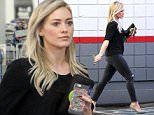 UK CLIENTS MUST CREDIT: AKM-GSI ONLY EXCLUSIVE: Beverly Hills, CA - 'Younger' actress, Hilary Duff, took her toned curves to the gas station in black ripped skinny jeans, black shirt, and suede pumps.  Pictured: Hilary Duff Ref: SPL916993  221214   EXCLUSIVE Picture by: AKM-GSI / Splash News