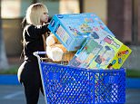 EXCLUSIVE: Blac Chyna seen leaving Babies 'R' Us with a cart full of toys in Los Angeles.  Pictured: Blac Chyna Ref: SPL916473  221214   EXCLUSIVE Picture by: VIPix / Splash News  Splash News and Pictures Los Angeles: 310-821-2666 New York: 212-619-2666 London: 870-934-2666 photodesk@splashnews.com