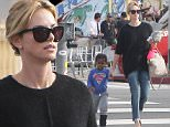 """Picture Shows: Jackson Theron, Charlize Theron  December 21, 2014    'Mad Max: Fury Road' actress Charlize Theron takes her son Jackson out for sushi in Los Angeles, California. Charlize recently talked about the hard time she had preparing for her role in the film, saying, """"The physical demand on my body and what I physically had to look like - I needed to build a lot of upper-body strength - was really hard for me to maintain.""""     Exclusive All Rounder  UK RIGHTS ONLY  Pictures by : FameFlynet UK    2014  Tel : +44 (0)20 3551 5049  Email : info@fameflynet.uk.com"""