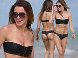 'Arrow' actress Katie Cassidy takes a walk on the beach in a black thong bikini in Miami beach, FL. Katie, 28, wore a black bandeau top with black and white polka dot thong bottoms. Katie wore a lot of jewerly for her beach outing, including a gold body chain.\n\nPictured: Katie Cassidy\nRef: SPL916107  201214  \nPicture by: Pichichi / Splash News\n\nSplash News and Pictures\nLos Angeles: 310-821-2666\nNew York: 212-619-2666\nLondon: 870-934-2666\nphotodesk@splashnews.com\n