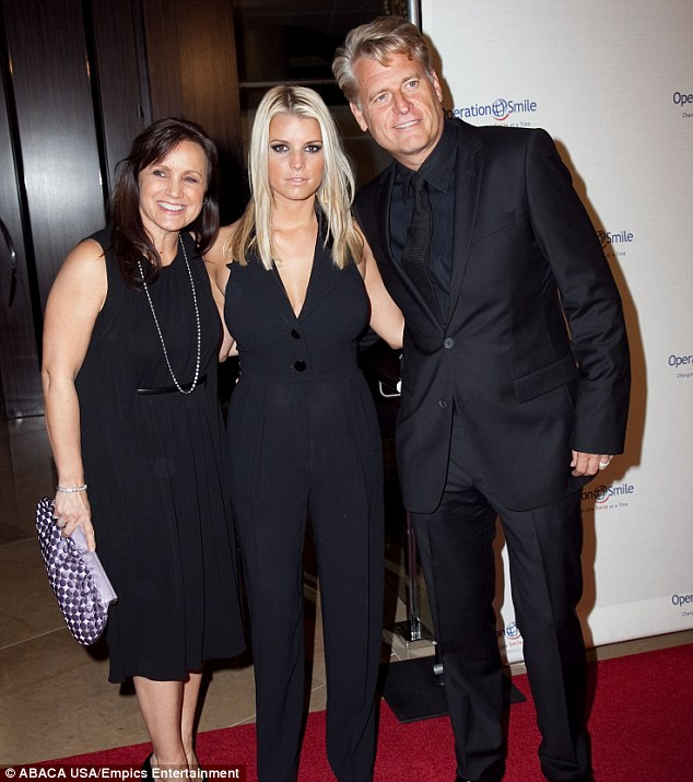 Family business: Tina, Jessica and Joe posed for a group shot at a charity event in 2009