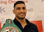 British boxer Amir Khan holds his WBC title belt and shorts prior to a press conference in Islamabad on December 24, 2014. Amir Khan has promised help to rebuild a Pakistani school where 150 people were massacred by the Taliban in the country's deadliest ever terror attack. Khan, who has Pakistani roots, travelled to the troubled country to show solidarity with the victims and their families. A team of heavily armed Pakistani Taliban gunmen stormed the army-run school in the northwestern city of Peshawar last week, slaughtering 150 people including 134 children. AFP PHOTO/ Aamir QURESHIAAMIR QURESHI/AFP/Getty Images