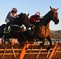 CHELTENHAM, ENGLAND - DECEMBER 13:  The New One riden by jockey Sam Twiston-Davies (R) jumps the final hurdle with Vaniteux riden by Barry Geraghty to win the StanJames.com International Hurdle Race at Cheltenham Racecourse on December 13, 2014 in Cheltenham, England.  (Photo by Christopher Lee/Getty Images)