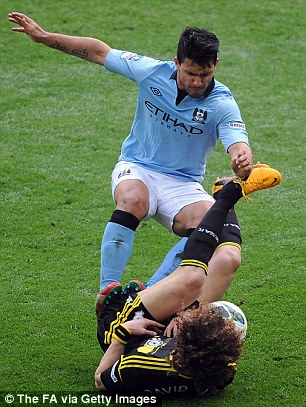 Lunging: Sergio Aguero apologised for this tackle on David Luiz
