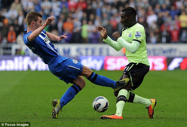 Lucky boy: Callum McManaman escaped without punishment for this challenge on Massadio Haidara