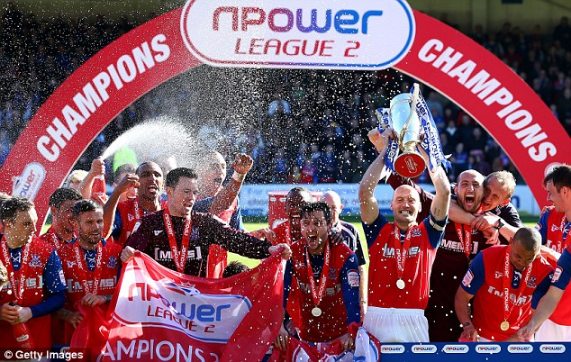 Done and dusted: Gillingham wrapped up the League Two title, but the real fun is at the foot of the table...