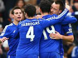 LONDON, ENGLAND - DECEMBER 26: John Terry of Chelsea celebrates scoring the opening goal with Diego Costa and Cesc Fabregas of Chelsea  during the Barclays Premier League match between Chelsea and West Ham United at Stamford Bridge on December 26, 2014 in London, England.  (Photo by Ian Walton/Getty Images)