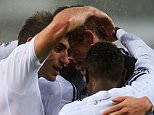 SWANSEA, WALES - DECEMBER 26:  Gylfi Sigurdsson of Swansea City (C) celebrates with team mates as as he scores their first goal during the Barclays Premier League match between Swansea City and Aston Villa at Liberty Stadium on December 26, 2014 in Swansea, Wales.  (Photo by Jan Kruger/Getty Images)