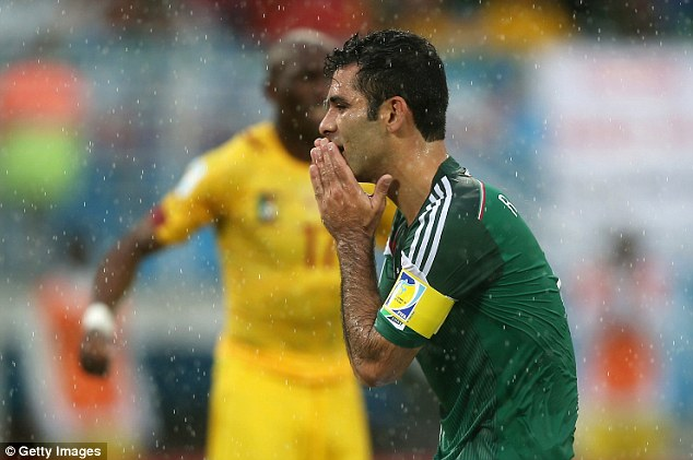 History maker: Mexico's Rafael Marquez wears the captain's armband in his fourth World Cup against Cameroon in the torrential rain of Natal