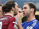Branislav Ivanovic of Chelsea and Andy Carroll of West Ham United square up after Chelsea player goes down in penalty area