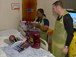 Pic by Avril Husband / Griffiths Photographers West Ham United players visit Newham General Hospital's Rainbow Ward. Kevin Nolan, Alex Song, Stewart Downing, James Collins, James Tomkins, Diego Poyet, Matt Jarvis and Mauro Zarate in attendance Newham General 16-12-2014